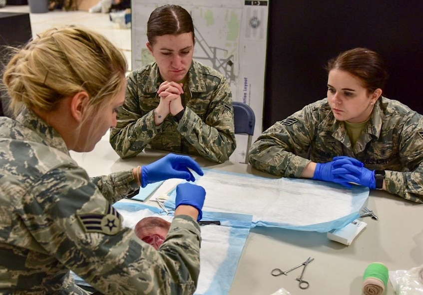 Members of the 914th Aeromedical Staging Squadron participate in a medical stitching exercise on Monday, April 10, 2017 at the Niagara Falls Air Reserve Station.  The training fulfills requirements in order to maintain medical skills and a current, qualified, mission ready force.  (U.S. Air Force photo by Staff Sgt. Richard Mekkri)