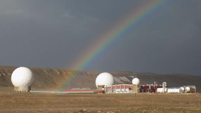 A rainbow arches across Thule Air Base, Greenland.  The base is the northernmost U.S. armed forces installation; its location providing increased efficiency for contact with polar orbiting satellites. (Courtesy Photo)