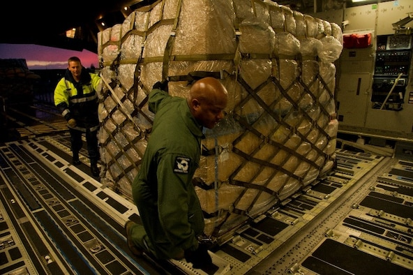 A member of the Royal New Zealand Air Force helps U.S. Air Force Master Sgt. Marc Staten, a 304th Expeditionary Airlift Squadron loadmaster, move a pallet onto a U.S. Air Force C-17 Globemaster III during Operation Deep Freeze July 15, 2016 at Christchurch International Airport, New Zealand. ODF is a joint operation between the U.S. Air Force, the National Science Foundation, and the RNZAF. Every year, a joint and total force team works to complete a successful ODF season. (Courtesy photo)