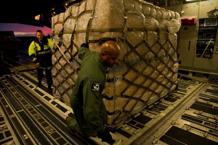 A member of the Royal New Zealand Air Force (RNZAF) helps U.S. Air Force Master Sgt. Marc Staten, 304th Expeditionary Airlift Squadron loadmaster, move a pallet onto a U.S. Air Force C-17 Globemaster III during Operation Deep Freeze (ODF), July 15, 2016 at Christchurch International Airport, New Zealand. ODF is a joint operation between the U.S. Air Force, the National Science Foundation, and the RNZAF. Every year, a joint and total force team works to complete a successful ODF season.