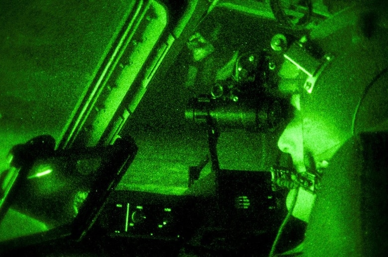 U.S. Air Force Capt. Andrew Rast, 304th Expeditionary Airlift Squadron pilot, uses night vision goggles to taxi a C-17 Globemaster III aircraft after landing at Pegasus Ice Runway, Antarctica during Operation Deep Freeze (ODF), July 15, 2016. ODF is the logistical support provided by the Department of Defense to the U.S. Antarctic Program (USAP). This includes the coordination of strategic inter-theater airlift, tactical intra-theater airlift and airdrop, and transportation requirements supporting the National Science Foundation, the lead agency for the USAP. (U.S. Air Force Reserve photo by Staff Sgt. Madelyn McCullough)