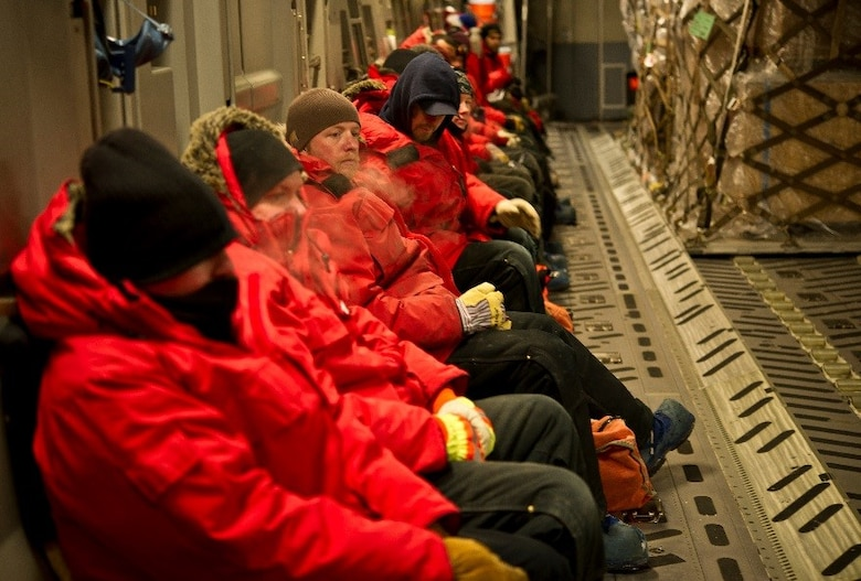 Passengers leaving Antarctica wait for cargo to finish being offloaded and onloaded onto a U.S. Air Force C-17 Globemaster III before takeoff during Operation Deep Freeze (ODF), July 15, 2016 at Pegasus Ice Runway, Antarctica. ODF is unlike any other U.S. military operation. Antarctica is the coldest, windiest, most inhospitable continent on the globe. Conditions are continuously monitored due to the unpredictable and quick-changing weather at the bottom of the world to ensure safety of aircraft, ships, cargo, passengers and crews while deployed in support of ODF. (U.S. Air Force Reserve photo by Staff Sgt. Madelyn McCullough)