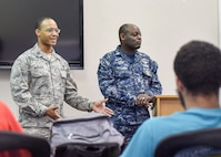 Capt. Anthony Burgess, an executive officer with the 910th Airlift Wing, introduces himself to approximately 25 students from the Inspiring Minds program who were here for a study and tutoring session April 13, 2017. Youngstown Air Reserve Station partners with Inspiring Minds, a non-profit K-12 youth organization based in Warren, Ohio, to provide mentorship and represent the Air Force Reserve as a career option. Volunteers from YARS devote personal time to mentorship, tutoring and fun activities with the students several times throughout the school year. (U.S. Air Force photo/Eric White)