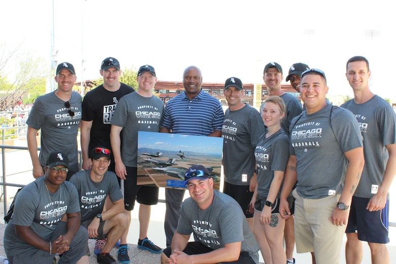 """Members of the 62nd Fighter Squadron and 62nd Aircraft Maintenance Unit pose with Bo Jackson at Camelback Ranch during a visit to the Chicago White Sox spring training facility March 20, 2017.  Jackson spoke about his appreciation for members of the military, including the importance of Luke Air Force Base to the Phoenix community.  He also stressed upon the Airmen of Luke the importance of taking care of each other and focusing on """"the little things."""""""