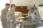 Two soldiers from the 571st Forward Support Company serve a hot meal at the 19th Expeditionary Sustainment Command Dining Facility at the 1st Republic of Korea Marine camp during Operation Pacific Reach Exercise 17 in Pohang, South Korea, April 14, 2017. Courtesy photo