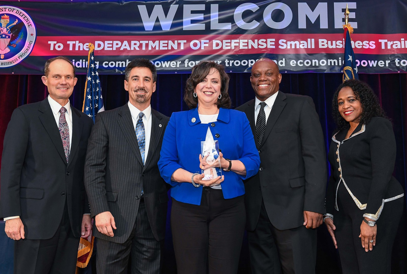 DLA Land and Maritime's Small Business Office received the Verdure Award during the DoD's annual Vanguard Awards ceremony April 6 in Atlanta, GA for significant contributions to buying method efficiency and innovation. From left: Dr. James Galvin, acting director of DoD Office of Small Business Programs; Carlo Daleo, Land and Maritime procurement analyst; Coleen McCormick, Land and Maritime Office of Small Business Programs associate director; Earl Madison, Land and Maritime small business specialist; Alice Williams, DoD Office of Small Business Programs acting deputy director.