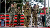 Col. Siale F. Diro, the Chief of Force Preparation, Papua New Guinea Defense Force, speaks during the opening ceremony of a bilateral military exchange held between the 11th Marine Expeditionary Unit and the PNGDF at Taurama Barracks, held as part of a theater security cooperation engagement, April 15. In order to prepare the PNGDF to support local police at upcoming national-level events, the Marines and Sailors with the 11th MEU will host bilateral training pertinent to civil authority operations, such as: entry control and vehicle check points, escalation of force tactics, personnel searches, urban patrolling and VIP escorts.