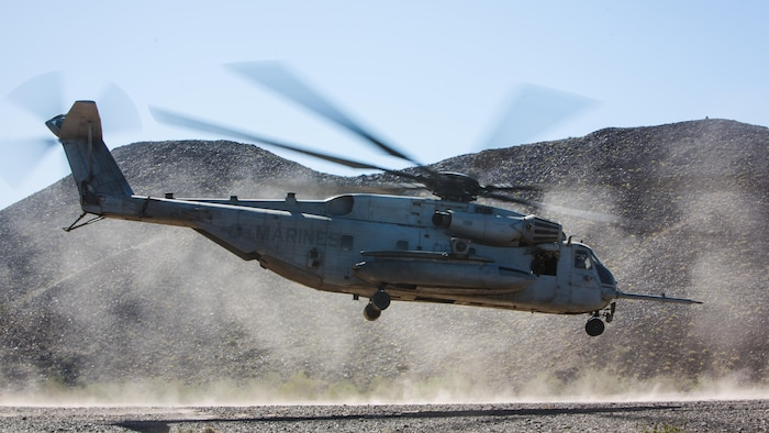 A CH-53E Super Stallion assigned to Marine Heavy Helicopter Squadron 466 takes off during a tactical support insert and extract exercise in part of Weapons and Tactics Instructors course 2-17 at Naval Air Facility El Centro, Calif., April 15, 2017. WTI is held biannually at Marine Corps Air Station Yuma, Ariz. to provide students with detailed training to be practiced on the various ranges in Arizona and California.