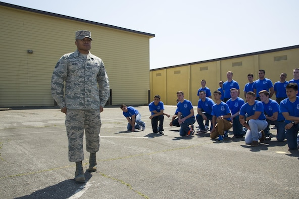 Tech. Sgt. Marc Gayden, Beale Honor Guard team lead, speaks with the 940th Air Refueling Wing's Development and Training Flight during Airman's time April 9, 2017, at Beale Air Force Base, California. Gayden spoke to the flight about commitment and how to be effective in the Air Force. (U.S. Air Force photo by Senior Airman Tara R. Abrahams)