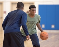 Airman 1st Class Julian Gerald, 11th Civil Engineer Squadron heating, ventilation and air conditioning technician, plays in a three-on-three basketball game at the West Fitness Center on Joint Base Andrews, Md., April 14, 2017. The game was part of a fundraising tournament supporting the Air Force Assistance Fund campaign.  Air Force bases worldwide participate in this campaign, raising money for four Air Force charities: Air Force Aid Society, Air Force Enlisted Village, Air Force Villages Charitable Foundation and the General and Mrs. Curtis E. LeMay Foundation.  (U.S. Air Force photo by Airman 1st Class Rustie Kramer)