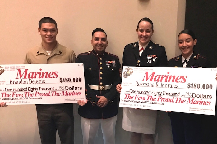 Captain Jennifer Mozzetta, executive officer for Recruiting Station Orlando, and Gunnery Sgt. Wilbert Vargas, station commander for Recruiting Substation Kissimmee, present Brandon Dejesus and Rosseana Morales with the Naval Reserve Officer Training Scholarship at Gateway High School, Kissimmee, FL April 12, 2017. The scholarship is extremely competitive and only the most qualified individuals who exhibit outstanding characteristics are selected.
