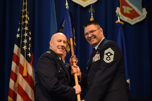 The 133rd Airlift Wing selected its thirteenth Command Chief during a ceremonial change of responsibility in St. Paul, Minn., Feb. 25, 2017. The outgoing U.S. Air Force Command Chief, Chief Master Sgt. Paul Kessler, passed the Wing's guidon to Chief Master Sgt. Lance Burg who assumed responsibility as the 13th senior enlisted advisor of the 133rd Airlift Wing. Both Kessler and Burg thanked their friends, family and mentors who had helped raise them to the Air Force's highest enlisted rank during their speeches at the ceremony.