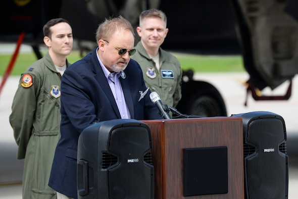 Mr. Jeff Thatcher, son of the World War II era Ruptured Duck's flight engineer, Staff Sgt. Jeff Thatcher, shares memories his father passed on to him before his passing during an unveiling ceremony for the new Ruptured Duck artwork, Apr. 17, 2017 at Wright-Patterson Air Force Base, Ohio. In addition to the unveiling, the B-1 aircraft was also christened by the Thatcher family.(U.S. Air Force photo / Wesley Farnsworth)