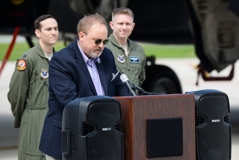 Mr. Jeff Thatcher, son of the World War II era Ruptured Duck's flight engineer, Staff Sgt. Jeff Thatcher, shares memories his father passed on to him before his passing during an unveiling ceremony for the new Ruptured Duck artwork, Apr. 17, 2017 at Wright-Patterson Air Force Base, Ohio. In addition to the unveiling, the B-1 aircraft was also christened by the Thatcher family. (U.S. Air Force photo by Wesley Farnsworth)
