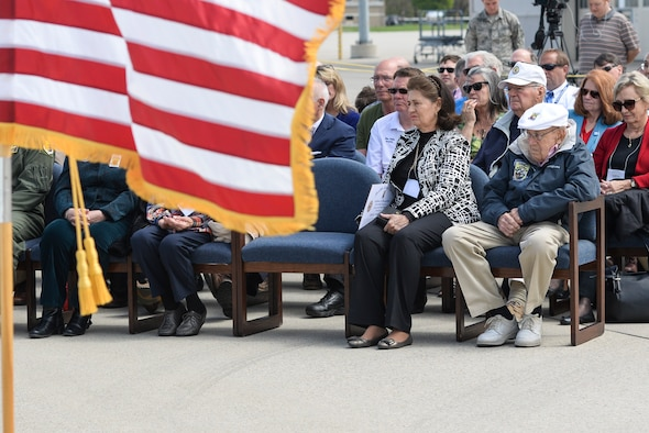 Retired Doolittle Raider, Lt. Col. Dick Cole, (front right) watches an unveiling ceremony for the new Ruptured Duck artwork, Apr. 17, 2017 at Wright-Patterson Air Force Base, Ohio. Cole is the last remaining member of the original Doolittle Raiders who took off from an aircraft carrier to deliver the first strike of the war on Japanese homeland. (U.S. Air Force photo by Wesley Farnsworth)