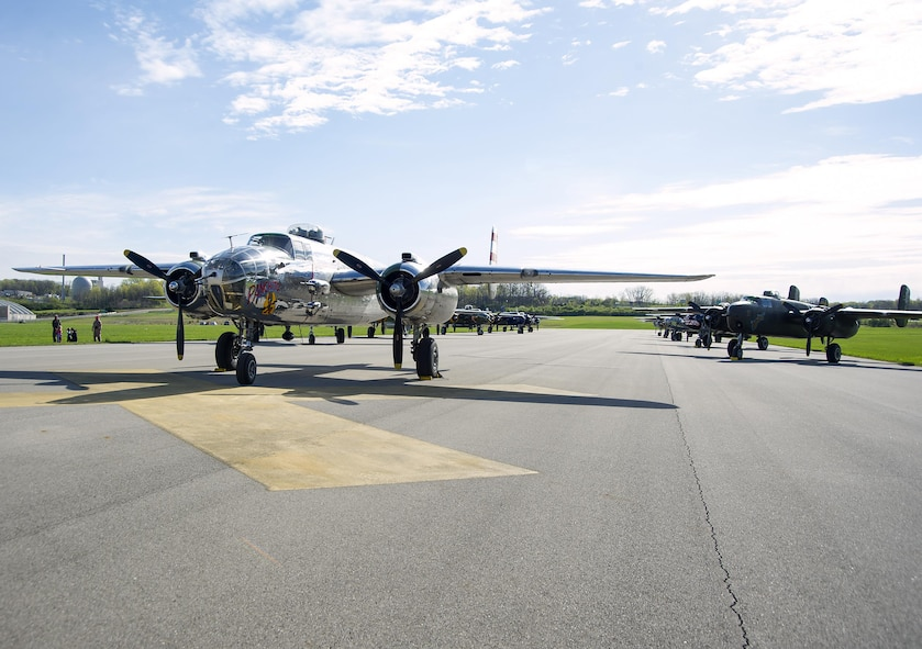 B-25 Mitchell bombers sit parked in a runway next to the National Museum of the U.S. Air Force at Wright-Patterson Air Force Base, Ohio, April 17, 2017. The 11 World War II era bombers landed at the museum to take part in its celebration of the 75th anniversary of the Doolittle Raid when Army Air Corps bombers took off from an aircraft carrier to deliver the first strike of the war on the Japanese homeland. (U.S. Air Force photo by R.J. Oriez/Released)