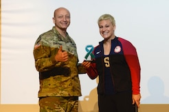 U.S. Army Maj. Gen. Anthony Funkhouser, Center for Initial Military Training commander, presents Kayla Harrison, Olympic Gold Medalist and guest speaker, with a gift during a Sexual Assault Awareness and Prevention Month event at Joint Base Langley-Eustis, Va., April 14, 2017. Harrison, a Judo player, began to tell her story  about her sexual assault experience last year after winning her second gold medal at the 2016 Olympics. (U.S. Air Force photo/Airman 1st Class Kaylee Dubois)