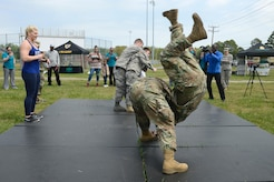 U.S. Army Soldiers flip each other during a Judo training with Kayla Harrison, Olympic Gold Medalist, as part of a Sexual Assault Awareness and Prevention Month event at Joint Base Langley-Eustis, Va., April 14, 2017. During the event, Soldiers had the opportunity to ask Harrison about her time as an Olympic athlete, her sexual assault experience and her judo techniques. (U.S. Air Force photo/Airman 1st Class Kaylee Dubois)