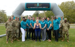 U.S. Army Soldier and Sexual Harassment, Assault Response and Prevention team members pose with Kayla Harrison, Olympic Gold Medalist, during a Sexual Assault Awareness and Prevention Month event at Joint Base Langley-Eustis, Va., April 14, 2017. Harrison, the guest speaker for the event, talked about raising sexual assault awareness, as well as setting and reaching goals to help survivors overcome trauma. (U.S. Air Force photo/Airman 1st Class Kaylee Dubois)
