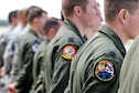 Members of the 34th Bomb Squadron from Ellsworth Air Force Base, S.D. stand in line during an unveiling ceremony for the new Ruptured Duck artwork, Apr. 17, 2017 at Wright-Patterson Air Force Base, Ohio.  The 34th BS lineage can be traced to one of the original Doolittle Raider squadrons. (U.S. Air Force photo by Wesley Farnsworth)