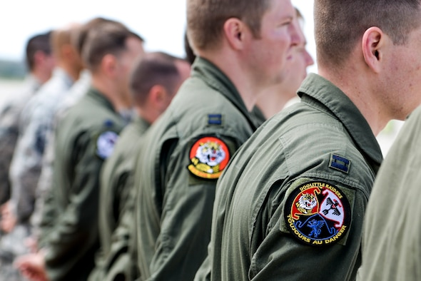Members of the 34th Bomb Squadron from Ellsworth Air Force Base, S.D. stand in line during an unveiling ceremony for the new Ruptured Duck artwork, Apr. 17, 2017 at Wright-Patterson Air Force Base, Ohio.  The 34th BS lineage can be traced to one of the original Doolittle Raider squadrons. (U.S. Air Force photo / Wesley Farnsworth)