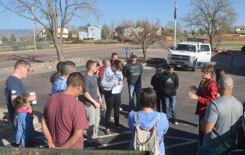 SCHREIVER AIR FORCE BASE, Colo. -- Sally Broomfield, Disaster Program Manager for Southeastern Colorado's American Red Cross, instructs 310th Space Wing volunteers on how to install fire alarms for families in the Cimarron Hills community during a Home Fire Campaign event on Saturday, Apr. 15th, 2017. The Red Cross responds to approximately 64,000 disasters each year with the vast majority being home fires, resulting in a goal to reduce fire-related deaths and injuries. (U.S. Air Force photo/Senior Airman Laura Turner)
