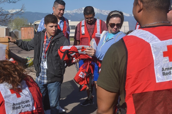 SCHREIVER AIR FORCE BASE, Colo. -- Southeastern Colorado's American Red Cross members hand safety vests out to 310th Space Wing volunteers who installed fire alarms for local families during a Home Fire Campaign event on Saturday, Apr. 15th, 2017. The Red Cross responds to approximately 64,000 disasters each year with the vast majority being home fires, resulting in a goal to reduce fire-related deaths and injuries. (U.S. Air Force photo/Senior Airman Laura Turner)