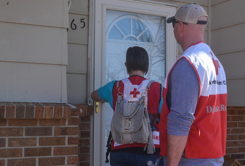 SCHREIVER AIR FORCE BASE, Colo. -- 310th Space Wing volunteers walk house-to-house in the Cimarron Hills community offering to install fire alarms, courtesy of the American Red Cross, during a Home Fire Campaign event on Saturday, Apr. 15th, 2017. The Red Cross responds to approximately 64,000 disasters each year with the vast majority being home fires, resulting in a goal to reduce fire-related deaths and injuries. (U.S. Air Force photo/Senior Airman Laura Turner)