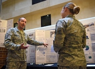 Master Sgt. Aaron Bowman, Gateway Innovation Center's NCO in charge, explains a Gateway Academy student's capstone presentation in the Wilford Hall Ambulatory Surgical Center Atrium on Joint Base San Antonio-Lackland, Texas, April 13, 2017. The Gateway Academy is the only entity of its kind in the Air Force Medical Service designed to administer/execute multiple courses related to the Gateway Performance System, continuous process improvement, patient safety, quality and clinical leadership. (U.S. Air Force photo/Staff Sgt. Jerilyn Quintanilla)