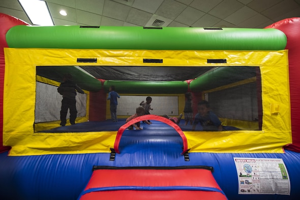 Children jump in a bounce-house during the Spring Fling Carnival at F.E. Warren Air Force Base, Wyo., April 15, 2017. The Easter Bunny also visited to mingle and take photos with the children. The 90th Force Support Squadron held the event for the local community to mark the start of spring and bring families together for a fun event. (U.S. Air Force photo by Staff Sgt. Christopher Ruano)