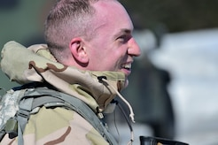"Spc. Michael Forlife, assigned to the 95th Chemical Company, ""Arctic Dragons"", 17th Combat Sustainment Support Battalion, U.S. Army Alaska, smiles when he takes off his protective mask after a Joint Service Lightweight Integrated Suit Technology stress fire at McGee range on Joint Base Elmendorf-Richardson, Alaska, April 13, 2017. The JSLIST is the product of a four-Service effort to field a common chemical protective clothing ensemble including a lightweight protective garment, multi-purpose overboots and gloves."