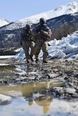 "Soldiers assigned to the 95th Chemical Company, ""Arctic Dragons"", 17th Combat Sustainment Support Battalion, U.S. Army Alaska, walk off the firing line after executing a Joint Service Lightweight Integrated Suit Technology stress fire at McGee range on Joint Base Elmendorf-Richardson, Alaska, April 13, 2017. The JSLIST is the product of a four-Service effort to field a common chemical protective clothing ensemble including a lightweight protective garment, multi-purpose overboots and gloves."