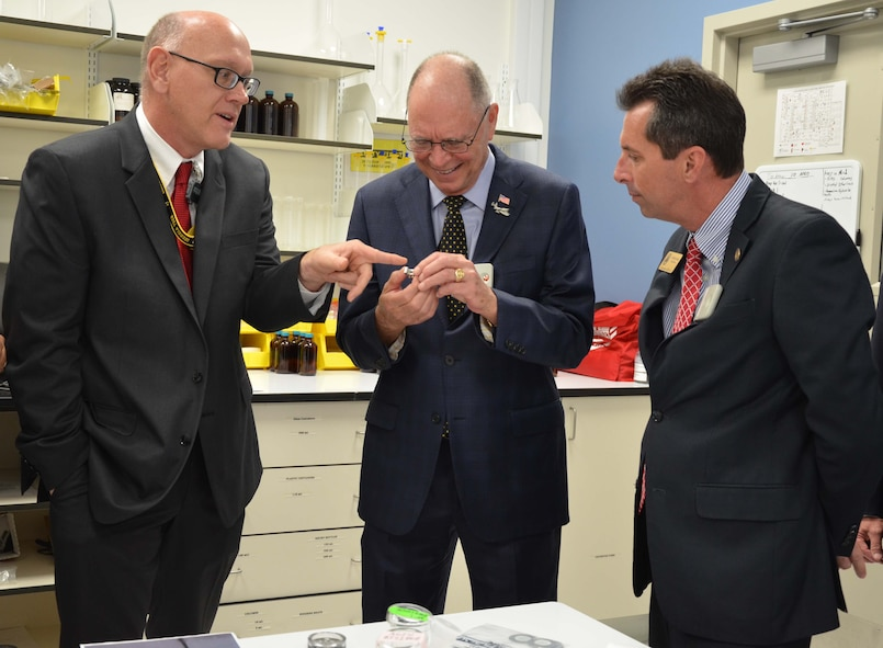 Dr. Bill Johnson (left), Ciambrone Radiochemistry Laboratory senior scientist, explains the science of trace-level analysis of environmental samples to U.S. Rep. Bill Posey from Florida's 8th Congressional District as Posey's District Director Patrick Gavin looks on.  The samples are analyzed using radiochemistry and mass spectrometry for low levels of nuclear materials. Posey and members of his staff visited the Air Force Technical Applications Center, Patrick AFB, Fla., for a mission update April 11, 2017.  (U.S. Air Force photo by Susan A. Romano)