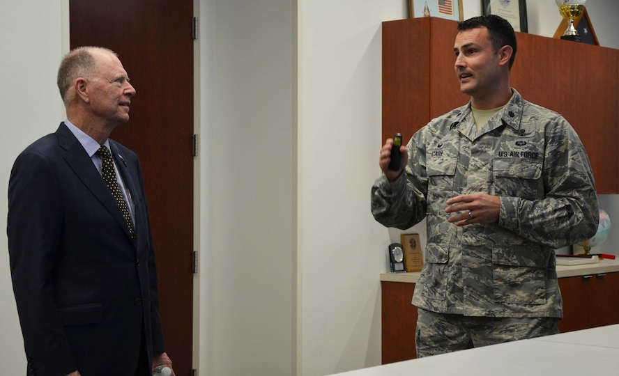 Lt. Col. Ehren Carl, commander of the Technical Surveillance Squadron, Air Force Technical Applications Center, Patrick AFB, Fla., briefs U.S. Rep. Bill Posey from Florida's 8th Congressional District about his squadron's involvement in detecting underground disturbances in the vicinity of North Korea's reported nuclear tests in January and September 2016.  Posey and members of his staff visited the nuclear treating monitoring center April 11, 2017 for a mission update. (U.S. Air Force photo by Susan A. Romano)