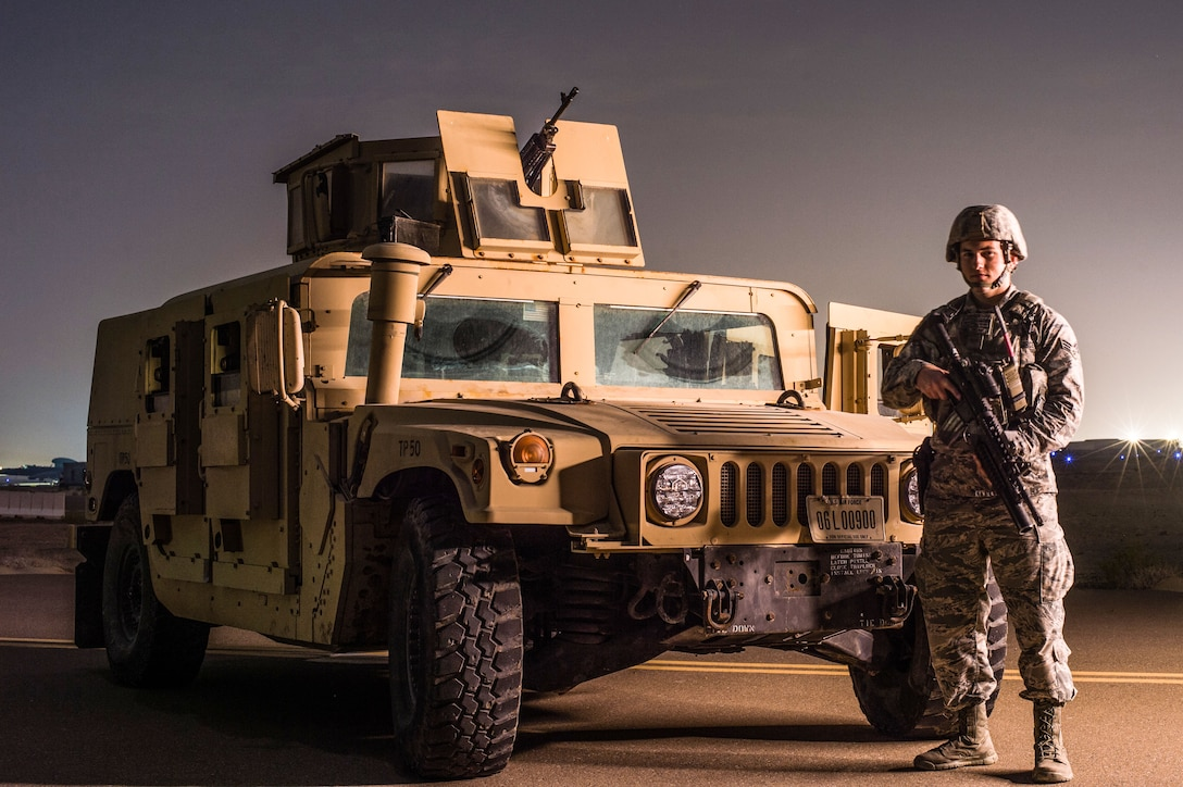 A member of the 380th Expeditionary Security Forces Squadron poses for a photo while guarding a U-2 Dragonlady at an undisclosed location in Southwest Asia, Feb. 8, 2017. Security forces members directly contribute to the area of responsibility by defending critical mission assets which are working to weaken and destroy Islamic State in Iraq and the Levant operations in the Middle East region and around the world. (U.S. Air Force photo/Senior Airman Tyler Woodward)