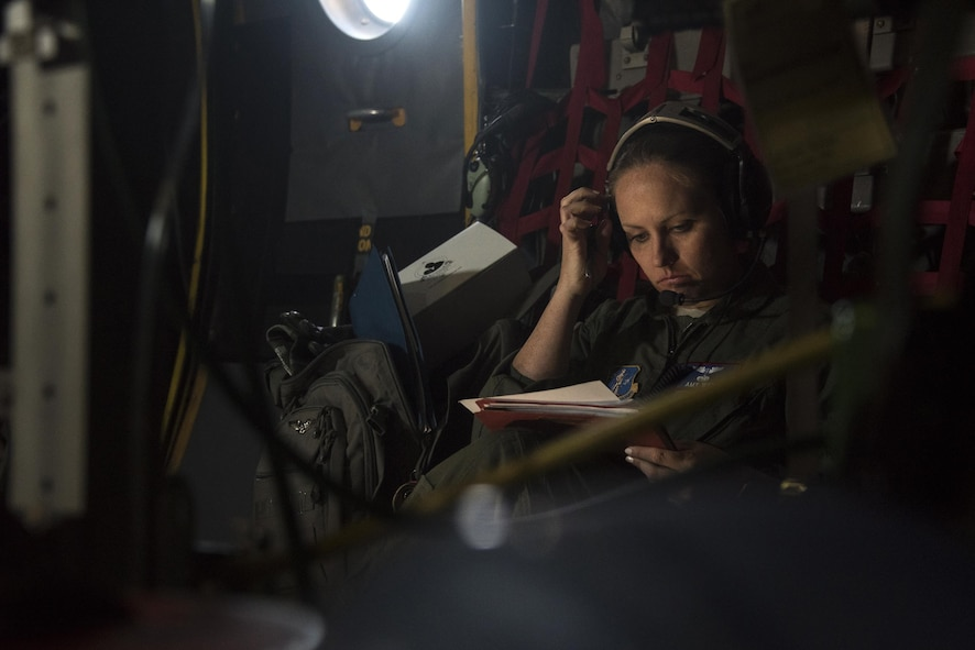 Capt. Amanda Wey, a flight nurse from the 183rd Aeromedical Evacuation Squadron, Mississippi Air National Guard, scans through checklists during a simulated flight on a static C-130 Hercules trainer at Will Rogers Air National Guard Base, April 7, 2017. The flight was part of the Multiple Aircraft Training Opportunity Program, or MATOP, that brought eight of the nine Air National Guard aeromedical evacuation squadrons and the three aircraft they most commonly fly on to one place for realistic and comprehensive training, April 6-9, 2017. (U.S. Air National Guard photo by Staff Sgt. Kasey Phipps)