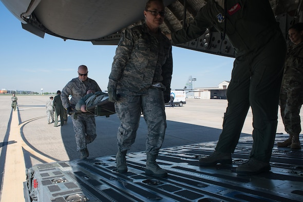 Tech. Sgt. Wendy Haggard and Capt. Patrick Cooper, both from the 137th Special Operations Medical Group, transport a simulated medical patient onto a C-17 Globemaster III at Will Rogers Air National Guard Base, Oklahoma City, during the Multiple Aircraft Training Opportunity Program (MATOP), April 7, 2017. Airmen of the 137 AES were joined by eight of the nine Air National Guard aeromedical evacuation squadrons as they hosted the annual training event and accomplished mandatory annual aeromedical training requirements. (U.S. Air National Guard photo by Senior Master Sgt. Andrew M. LaMoreaux/Released)