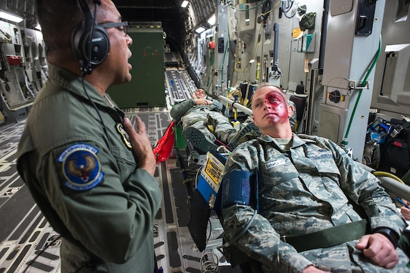 Tech. Sgt. Angel Delacruz, 146th Aeromedical Evacuation Squadron technician, provides simulated medical treatment to Senior Airman Zachary Hart, a volunteer simulated patient, on a C-17 Globemaster III during the Multiple Aircraft Training Opportunity Program (MATOP) organized by the 137th Aeromedical Evacuation Squadron from Will Rogers Air National Guard Base, Oklahoma City, April 7, 2017. Airmen of the 137 AES were joined by eight of the nine Air National Guard aeromedical evacuation squadrons as they hosted the annual training event and accomplished mandatory annual aeromedical training requirements.(U.S. Air National Guard photo by Senior Master Sgt. Andrew M. LaMoreaux/Released)