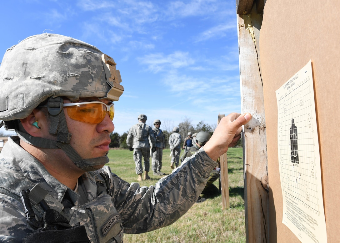 Staff Sgt. Juan Nunez a security forces specialist with the 136th Security Forces Squadron, Texas Air National Guard, inspects his shot groupings at the M4 carbine zeroing range during the Texas Military Department Best Warrior Competition March 3, 2017, at Camp Swift, Bastrop, Texas. The competitors shot 18 rounds to zero their weapons at 25 meters. (Air National Guard photo by Senior Airman De'Jon Williams)