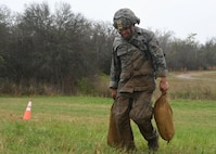 Staff Sgt. Juan Nunez a security forces specialist with the 136th Security Forces Squadron, Texas Air National Guard, carries sandbags to a set up point March 4, 2017, during the Texas Military Department Best Warrior Competition at Camp Swift, Bastrop, Texas. Nunez built a sandbag wall on during the mystery event on the final day of competition. (Air National Guard photo by Senior Airman De'Jon Williams)