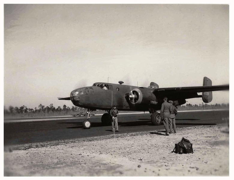 Aircraft 40-2231 practicing short takeoffs on an unknown auxiliary field on the Eglin military reservation in preparation for the historic Doolittle Raid.  Members and aircraft of the 17th Bombardment Group (Medium), Columbia Army Airfield, South Carolina, spent most of March 1942 training for the Doolittle Raid.  (Courtesy of the Doolittle Organization)