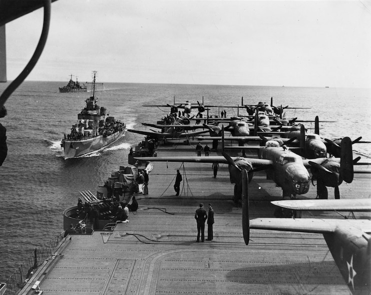 Most of the 16 B-25 medium bombers on the back half of the USS Hornet somewhere in the Pacific in April 1942.  Capt. Marc Mitscher, the commander of the Hornet, managed to load 16 of the Army Air Force bombers on the carrier's flight deck.  (US Navy official photo)