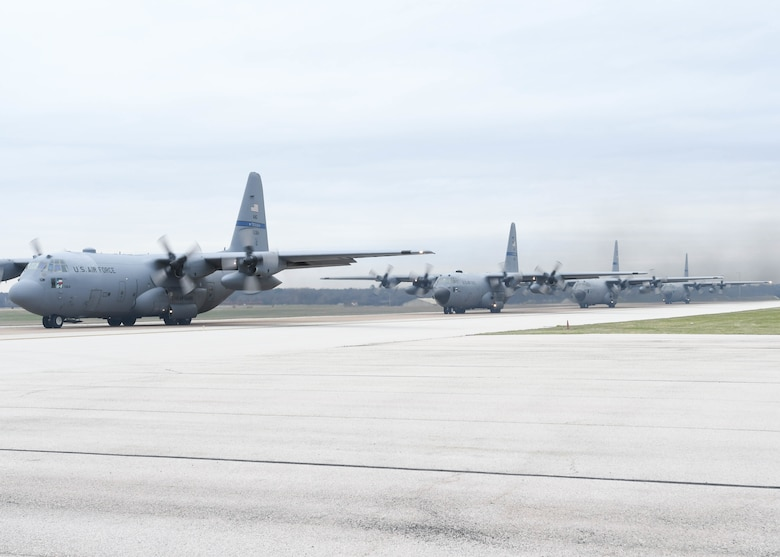 Four C-130H2 Hercules aircraft from the 136th Airlift Wing, Texas Air National Guard, line up along the runway preparing for take off, Feb. 26, 2017 at Naval Air Station Fort Worth Joint Reserve Base, Texas. These aircraft were the first of six to take off during a max-fly effort utilizing only traditional Airmen. (Air Force photo by Senior Airman De'Jon Williams)