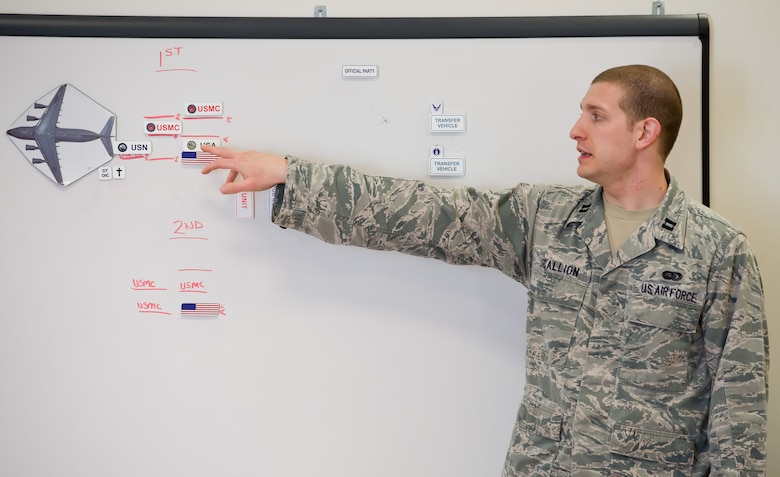 Capt. Brian Scallion, Air Force Mortuary Affairs Operations, dignified transfer officer in charge, briefs the transfer sequence to Folded Flag 2017 carry teams April 11, 2017, on Dover Air Force Base, Del. AFMAO held a joint service training exercise that tested its ability to respond to a mass casualty incident. (U.S. Air Force photo by Roland Balik)