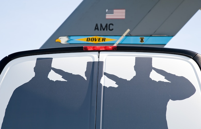 An Air Force Mortuary Affairs Operations public affairs van is parked facing the tail of a C-17 Globemaster III during the Folded Flag 2017 mass casualty exercise April 11, 2017, on Dover Air Force Base, Del. Public Affairs broadcast journalists from AFMAO and the 436th Airlift Wing, as well as 436th AW PA photojournalists participated in a joint service mass casualty training exercise by documenting 12 simulated dignified transfers. (U.S. Air Force photo by Roland Balik)