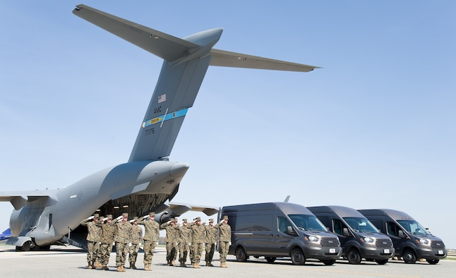 U.S. Marines render a final salute as the doors of the mortuary transfer vehicles are closed during Folded Flag 2017 April 11, 2017, on Dover Air Force Base, Del. The Marines participated in the joint service training exercise that tested the ability of the Air Force Mortuary Affairs Operations to respond to a mass casualty incident. (U.S. Air Force photo by Roland Balik)
