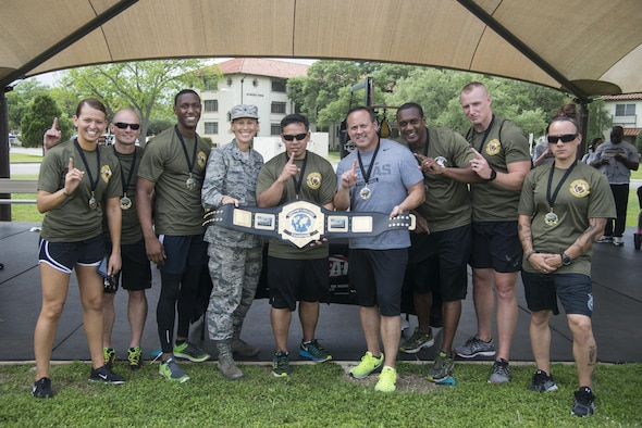 "The 902nd Security Forces Squadron ""Survivor's Challenge"" team posses with Brig. Gen. Heather Pringle, 502nd Air Base Wing and Joint Base San Antonio commander, after winning first place during the competition April 13, 2017, at Joint Base San Antonio-Randolph. Survivor's Challenge is a JBSA competition where teams compete in mental and physical challenges to help raise awareness and prevent sexual assault within the military and federal service.  (U.S. Air Force photo by Sean M. Worrell)"