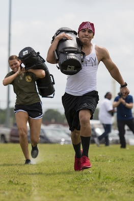 "A member of the Army #1 team races to the finish line carrying a 60 pound bag during the ""Survivor's Challenge"" April 13, 2017, at Joint Base San Antonio-Randolph.  Survivor's Challenge is a JBSA competition where teams compete in mental and physical challenges to help raise awareness and prevent sexual assault within the military and federal service.  (U.S. Air Force photo by Sean M. Worrell)"