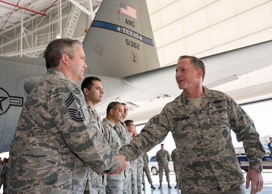 Air Force Chief of Staff Gen. David L. Goldfein coins Chief Master Sgt. Huey McKinney, 136th Airlift Wing, Texas Air National Guard aircraft maintenance superintendent, during a visit to Naval Air Station Fort Worth Joint Reserve Base, Texas, Jan. 29, 2017. McKinney was coined for his work with the Inspector General program during the past year. (Air National Guard photo by Senior Master Sgt. Elizabeth Gilbert)