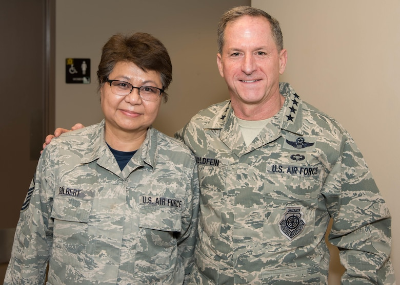 Air Force Chief of Staff Gen. David L. Goldfein and Senior Master Sgt. Elizabeth Gilbert, 136th Airlift Wing Public Affairs superintendent, Texas Air National Guard, pose for a photo during his visit to Naval Air Station Fort Worth Joint Reserve Base, Texas, Jan. 29, 2017. Gilbert was coined for her 40 years of service in the Air Force and lifetime achievement award in public affairs. (Air National Guard photo by Senior Airman De'Jon Williams)